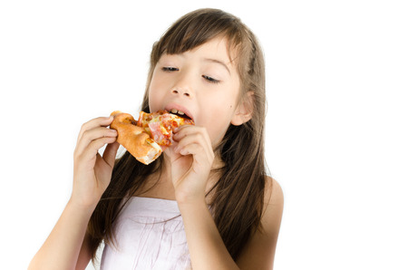 Little girl eating pizza on white background Stock Photo