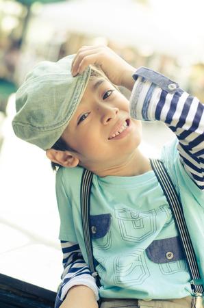 restuarant: Little boy sitting at the restuarant vintage filter