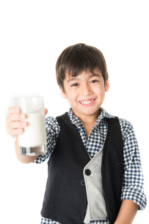 Little boy drinking milk on white background;