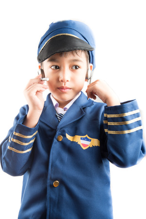 pretend: Little boy pretend as a pilot on white background