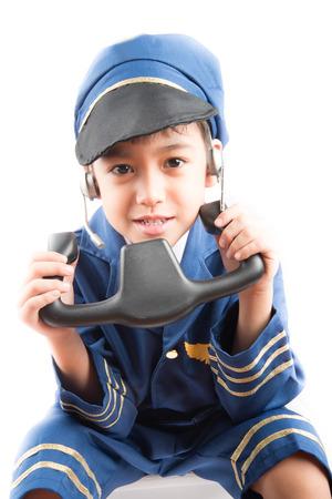 pretend: Little boy pretend as a pilot on white background