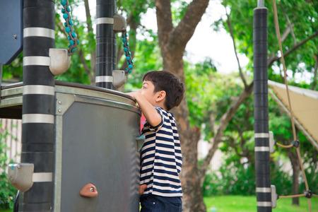 jungle boy: Little boy climbing  at playground