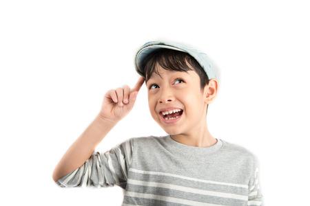 Little boy thinking surprise face get idea on white background Foto de archivo