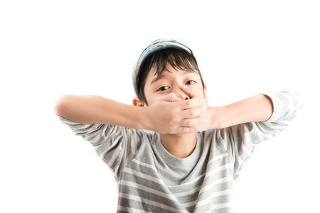 shutting: Little boy hand closing mouth on white background