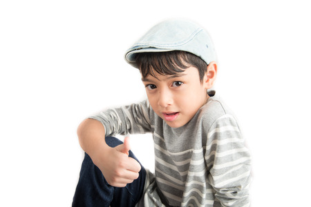 thump: Little boy pose portrait with thump up on white background
