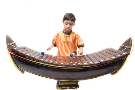thailand art: Little boy learning Thai instument Xylophone, Ranat,