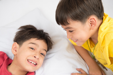 asian hospital: Little sibling boy lay on the pillow  together