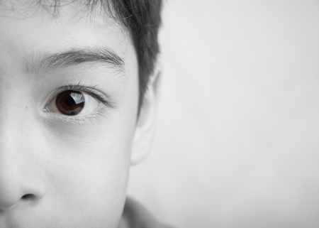 indian boy: Close up spot color eyes of boy black and white Stock Photo
