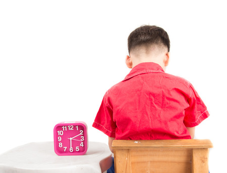 bad behavior: Little boy is punishing on time out