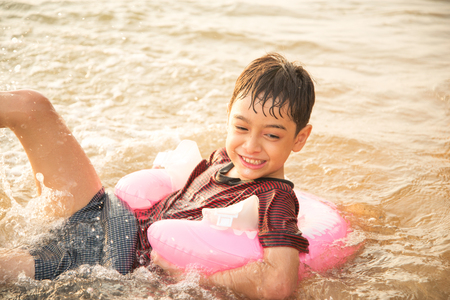 little boy swimming: Little boy swimming on the beach Stock Photo