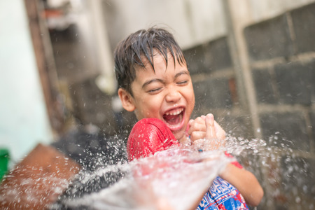 Little boy playing water splash