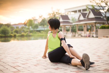 excercise: Asian woman working out excercise in the park Stock Photo