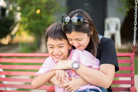 son: Beautiful Woman hug little boy