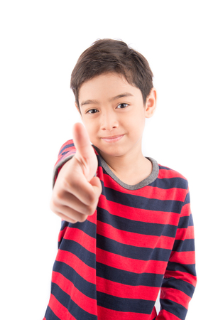 thump: Little boy showing his thump up on white background Stock Photo