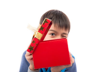 opening gift: Little boy opening gift present box on white background