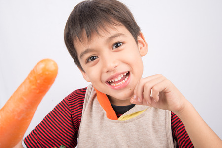 3 year old boy: Little boy eating carrot