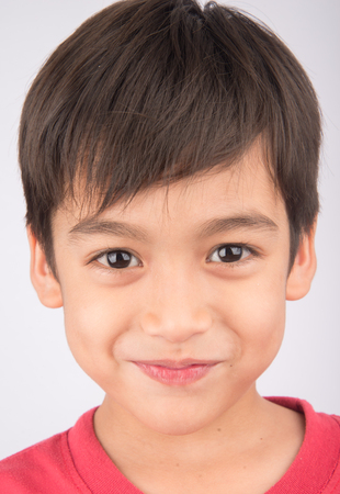 7 year old boys: Close up face with smiling kid portrait