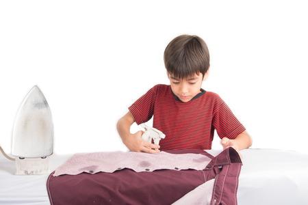 Little boy ironing house work