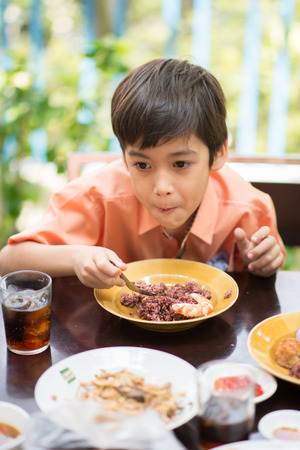 restuarant: Little boy eating for food  meal in the restuarant outdoor