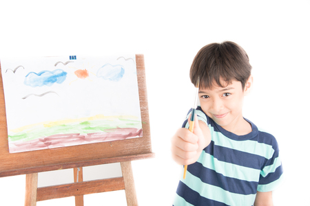 brush painting: Little boy drawing and painting picture art  in the paper