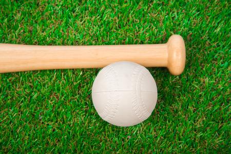 infield: Baseball bat on the grass
