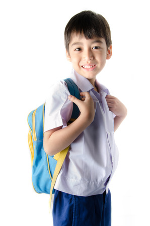 school uniforms: Little student boy in uniform on white background