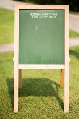 a public notice: Green board in the park Stock Photo