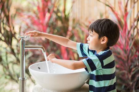 Boy washing hand