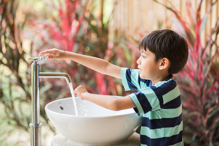 Boy washing hand Stock Photo - 56371502