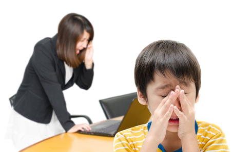 dysfunctional: Asian business woman  screaming and kid crying while on white background