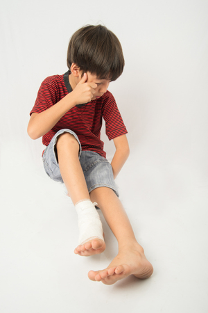 accident rate: Little boy has an accident with his leg need bandage for first aid