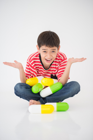 Little boy taking medicine drug