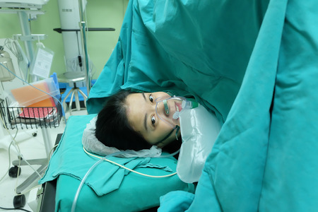 cesarean pregnancy mother in operation room giving birth baby wrong position out from bottom