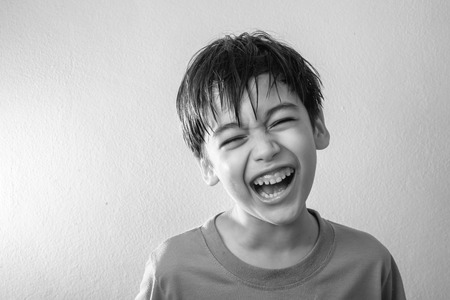 laughing face: Little boy mix rate laughing with happy face on Black and white style
