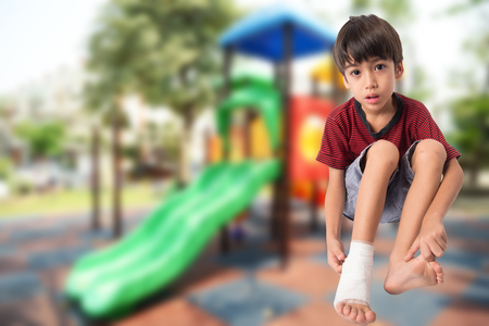 accident rate: Little boy in accident on his foot at playground