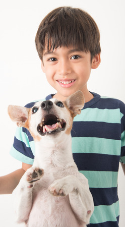 russel: Little boy playing with his friend dog jack russel