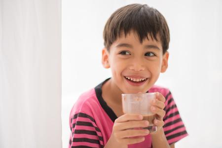 Little boy drinking milk vintage color style Archivio Fotografico