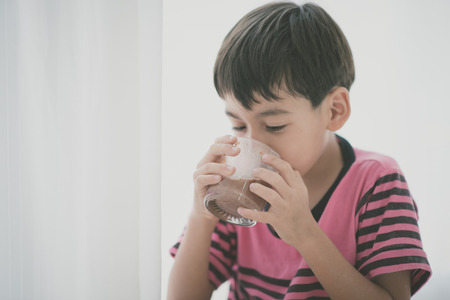 Little boy drinking milk vintage color style Stock Photo