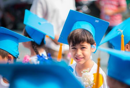 Little boy graduated at kindergarten school Stock Photo
