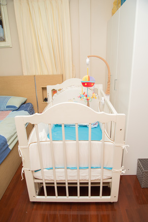 family  room: Family room with baby bed