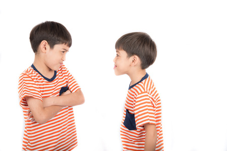sibling rivalry: Little sibling boy fighting brother on white background