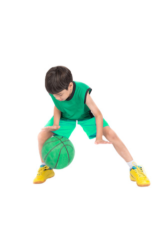 Little boy playing greea basketball in green PE uniform sport  with clipping path isolate on white background