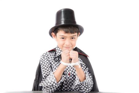 abracadabra: Little boy pretend as a magician performance with fun Stock Photo