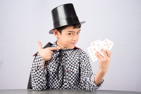 Little boy pretend as a magician performance with fun Stock Photo
