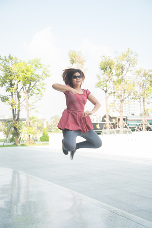 happyness: Woman jumping in the parkwith happyness summer time Stock Photo