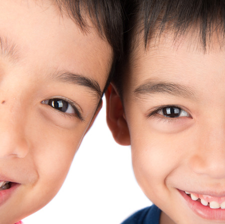 sibling: Close up on eyes of sibling brother smiling together