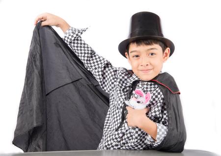 pretend: Little boy pretend as a magician performance with fun Stock Photo