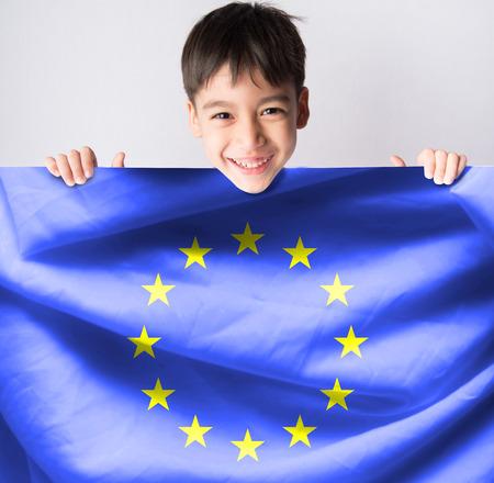 european: Littleboy taking european flag