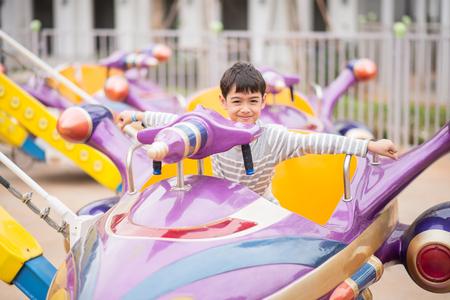 Little boy in amusement park