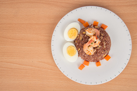 low fat: Fired brown rice with shrimp, carrot  and boiled egg healthy clean food none oil added low fat